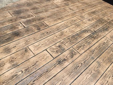 Stamped concrete hardwood floor home flooring ideas for Hardwood floor concrete stamp